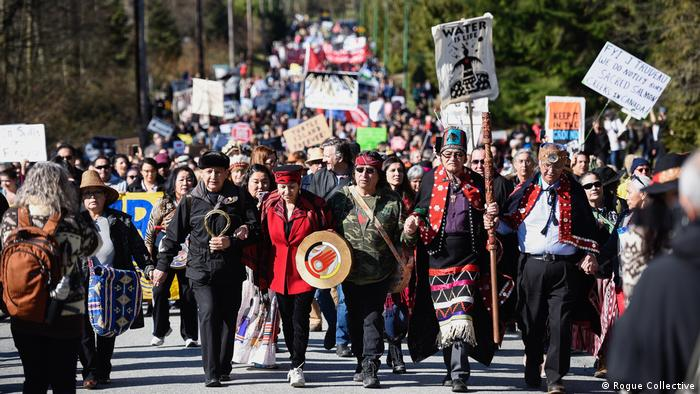 Thousands of people march in British Columbia in March 2018 to protest the Kinder Morgan Trans Mountain pipeline
