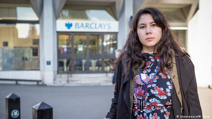 Canadian First Nations activist Ocean Hyland in front of a Barclays in London