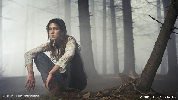 Charlotte Gainsbourg playing the protagonist out in the woods in Antichrist
