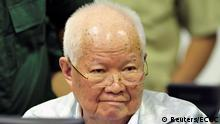 Former Khmer Rouge head of state Khieu Samphan sits inside the courtroom of the Extraordinary Chambers in the Courts of Cambodia (ECCC) as he awaits a verdict, on the outskirts of Phnom Penh, Cambodia, November 16, 2018. Extraordinary Chambers in the Courts of Cambodia (ECCC)/Handout via REUTERS ATTENTION EDITORS - THIS IMAGE WAS PROVIDED BY A THIRD PARTY. THIS PICTURE WAS PROCESSED BY REUTERS TO ENHANCE QUALITY. AN UNPROCESSED VERSION HAS BEEN PROVIDED SEPARATELY. TPX IMAGES OF THE DAY