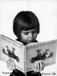 A young girl in the GDR reading a book