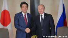 Singapur: Minister Shinzo Abe und Präsident Wladimir Putin