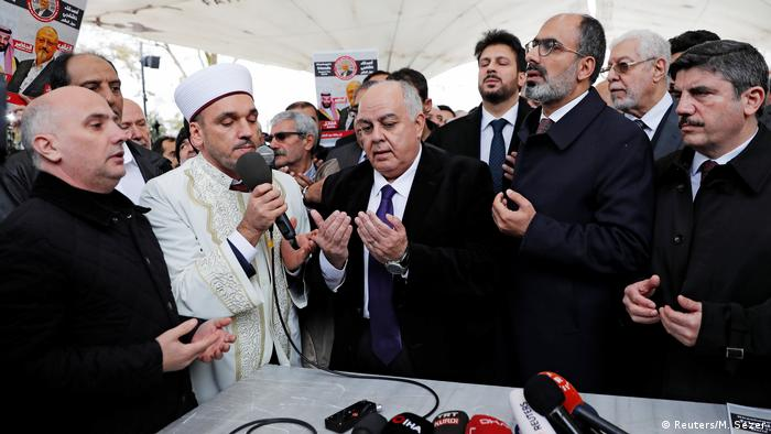 Men gather at the symbolic funeral service for murdered journalist Jamal Khashoggi in the Fatih Mosque courtyard in Istanbul. (Reuters/M. Sezer)