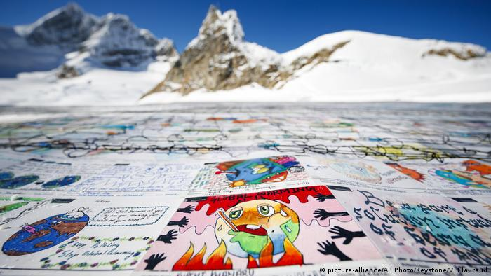A giant postcard is pictured on the Aletsch glacier.