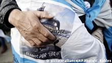 15.11.2018 Relatives of the missing crew of the ARA San Juan submarine, embrace in mourning after a ceremony remembering the one year anniversary of the disappearance of the submarine, at the Navy base in Mar del Plata, Argentina, Thursday, Nov. 15, 2018. The submarine disappeared in the South Atlantic with with 44 crew members aboard. (AP Photo/Vicente Robles) |