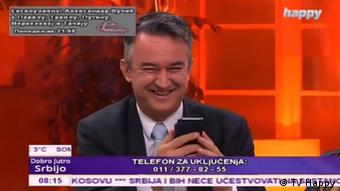 Darko Mladic smiles while talking to his father on air