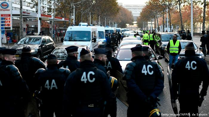 Police stand in the road during a yellow vest demonstration in France
