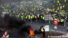 Protesters in high-visibility vests block roads in France (Reuters/S. Mahe)