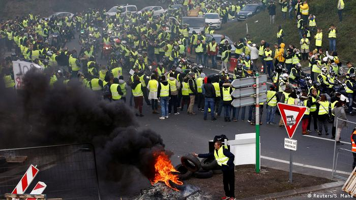 Protesters in high-visibility vests block roads in France