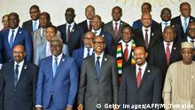 Africa Union Commission Chairperson, Moussa Faki Mahamat (2ndL front row) poses for a family photo on November 17, 2018 with Africa's Presidents (fromL) Sudan's Omar al-Bashir, Rwanda's Paul Kagame, Ethiopia's Prime Minister Abiy Ahamed and Chad's Idris Deby, on the sidelines of a AU summit in Addis Ababa. (Photo by MICHAEL TEWELDE / AFP) (Photo credit should read MICHAEL TEWELDE/AFP/Getty Images)