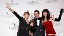 (L-R) Sonia Martinez, show creator Alex Pina and Esther Martinez Lobato from Spain pose with their award for Drama Series for their work on La Casa de Papel (Money Heist) at the International Emmy Awards in Manhattan, New York City, U.S., November 19, 2018. REUTERS/Andrew Kelly