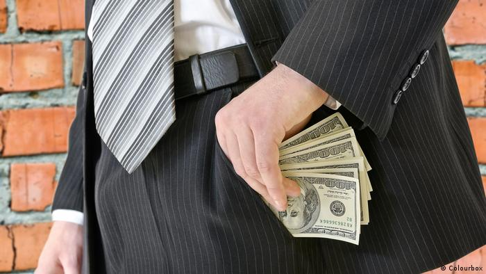 Man in a business suit puts money in your pocket