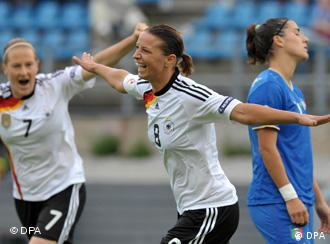Inka Grings celebrates a goal for Germany