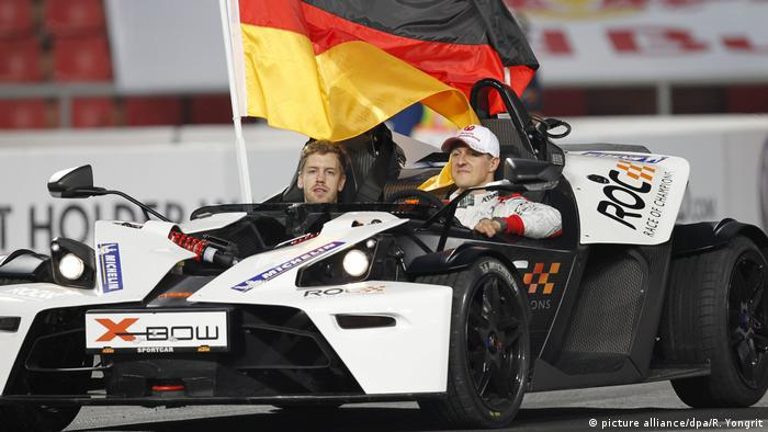 Sebastian Vettel and Michael Schumacher in a KTM X-Bow at the 2012 RoC in Bangkok, Thailand. Photo from 15.12.2012. (picture alliance/dpa/R. Yongrit)