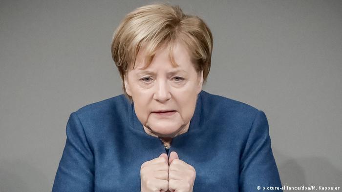 Angela Merkel broniła w Bundestagu paktu migracyjnego ONZ
