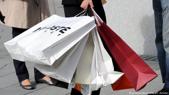 A person holding shopping bags