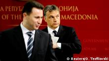FILE PHOTO: Macedonian Prime Minister Nikola Gruevski (L) stands in front of his Hungarian counterpart Viktor Orban during news conference in Skopje May 12, 2011. Prime Minister Orban is on a one-day official visit to Macedonia. REUTERS/Ognen Teofilovski/File Photo