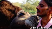 An Indian nomad with a camel