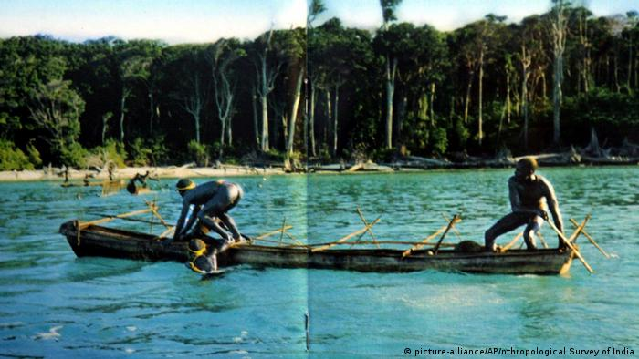 An undated photo showing Sentinelese tribal men rowing their canoe in the Andaman and Nicobar archipelago