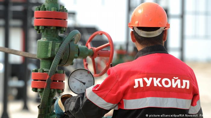 Lukoil employee at an oil pump