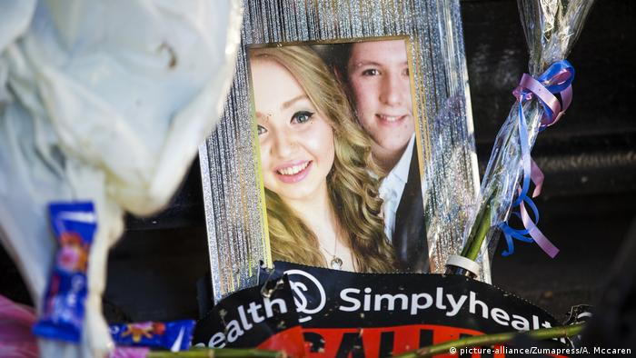 A photograph of Chloe Rutherford, age 17, and Liam Curry, age 19, who where killed in the Manchester Arena attack, left at St Ann's square.
