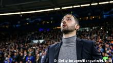 60.11.2018 GELSENKIRCHEN, GERMANY - NOVEMBER 06: Domenico Tedesco, Head Coach of FC Schalke 04 reacts looks on prior to the Group D match of the UEFA Champions League between FC Schalke 04 and Galatasaray at Veltins-Arena on November 6, 2018 in Gelsenkirchen, Germany. (Photo by Maja Hitij/Bongarts/Getty Images)