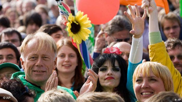 Green Party leaders Jürgen Tritten and singer Nina Hagen Berlin (AP)