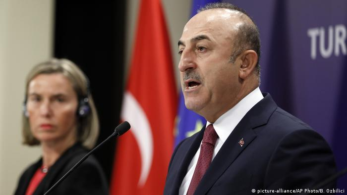 Federica Mogherini stares at Mevlut Cavusoglu during a press conference in Ankara