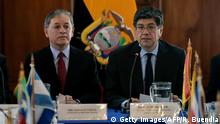 Ecuadoran Foreign Minister Jose Valencia (R) and Ecuadorean Vice-Minister of Human Mobility, attend the second regional meeting to address the huge flow of Venezuelan migrants at the Foreign Ministry in Quito on November 22, 2018. (Photo by RODRIGO BUENDIA / AFP) (Photo credit should read RODRIGO BUENDIA/AFP/Getty Images)