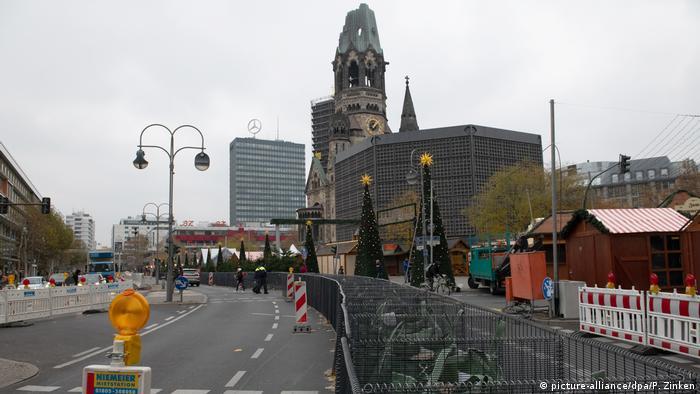 Workers install a barricade around Breitscheidplatz