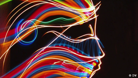 Eco Africa - A colorful artwork created with lights; a woman's profile on a black background