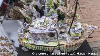 Paper sculptures made out of worthless Venezuelan banknotes