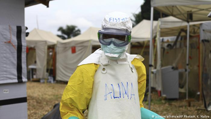 A health worker in protective gear works at an Ebola treatment center in Beni, Eastern Congo
