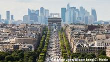 The Arc De Triomphe stands while automobiles travel on the Avenue des Champs-Elysees as skyscrapers sit on the city skyline in the La Defense business district in Paris, France on Tuesday, July 12, 2016. Cities across Europe are eyeing the spoils of the British referendum result, making a pitch to businesses large and small that want to secure access to the single market of the remaining 27 countries of the EU. Photographer: Christophe Morin/Bloomberg via Getty Images