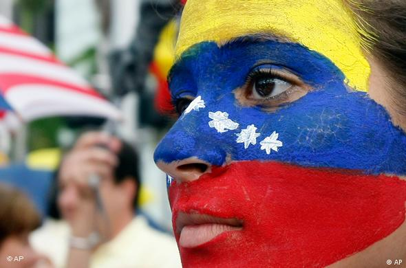 Viviana Covia, of Miami, with the Venezuelan flag painted on her face, participates during an anti-Chavez protest in Miami, Friday, Sept. 4, 2009. Thousands of opponents of Hugo Chavez marched against the Venezuelan president across Latin America on Friday, accusing him of everything from authoritarianism to international meddling. The protests, coordinated through Twitter and Facebook, drew more than 5,000 people in Bogota, and thousands more in the capitals of Venezuela and Honduras. Smaller demonstrations were held in other Latin American capitals, as well as New York and Madrid. (AP Photo/Alan Diaz)