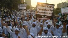 Islamist activists carry placards against Asia Bibi, a Pakistani Christian woman who was recently released after spending eight years on death row for blasphemy, during a rally coinciding with Eid Milad-un-Nabi, which marks the birth anniversary of Prophet Muhammad, in Karachi on November 21, 2018. (Photo by ASIF HASSAN / AFP) (Photo credit should read ASIF HASSAN/AFP/Getty Images)