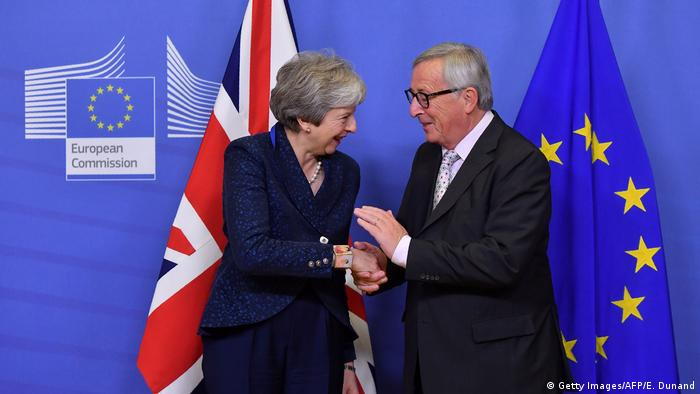 Theresa May and Jean-Claude Juncker shake hands in Brussels (Getty Images/AFP/E. Dunand)