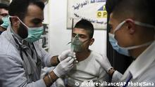 In this photo released by the Syrian official news agency SANA, shows a man receiving oxygen through respirators following a suspected chemical attack on his town of al-Khalidiya, in Aleppo, Syria, Saturday, Nov. 24, 2018. Some 50 civilians were being treated following a suspected poison gas attack by Syrian rebel groups on the government-held Aleppo city in the country's north, according to Syrian state media. (SANA via AP) |