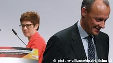 22.11.2018, Halle/Saale: Annegret Kramp-Karrenbauer, CDU-Generalsekretärin, und Friedrich Merz, ehemaliger Fraktionsvorsitzender der CDU/CSU, gehen auf der Regionalkonferenz der CDU für Sachsen-Anhalt und Sachsen von der Bühne. Die aussichtsreichsten Bewerber für die Nachfolge an der CDU-Parteispitze stellen sich den CDU-Mitgliedern vor. Foto: Hendrik Schmidt/dpa-Zentralbild/dpa | Verwendung weltweit