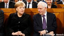 German Chancellor Angela Merkel speaks with President of the Central Council of Jews in Germany Josef Schuster as they take part in a ceremony to mark the 80th anniversary of Kristallnacht, also known as Night of Broken Glass, at Rykestrasse Synagogue, in Berlin, Germany, November 9, 2018. REUTERS/Fabrizio Bensch