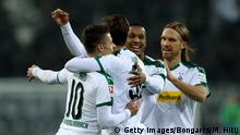 MOENCHENGLADBACH, GERMANY - NOVEMBER 25: Thorgan Hazard #10 of Gladbach celebrate with team mates after he scores the equalizing goal during the Bundesliga match between Borussia Moenchengladbach and Hannover 96 at Borussia-Park on November 25, 2018 in Moenchengladbach, Germany. (Photo by Maja Hitij/Bongarts/Getty Images)