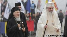 Romanian Patriarch Daniel, right, and Ecumenical patriarch Bartholomew I, left, arrive for the consecration of the new People's Salvation Cathedral in Bucharest, Romania, November 25, 2018. Inquam Photos/Octav Ganea via REUTERS ATTENTION EDITORS - THIS IMAGE WAS PROVIDED BY A THIRD PARTY. ROMANIA OUT.