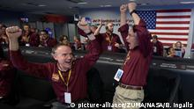 Nov 26, 2018 - Pasadena, California, U.S. - Mars InSight team members KRIS BRUVOLD, left, and SANDY KRASNER react after receiving confirmation that the Mars InSight lander successfully touched down on the surface of Mars, Monday, inside the Mission Support Area at NASA's Jet Propulsion Laboratory |