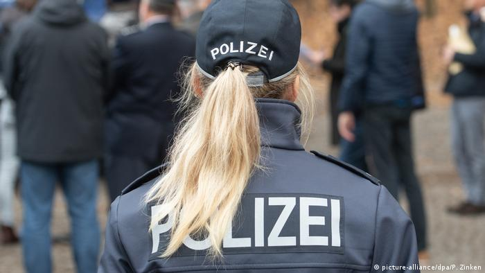 A German police woman has her back to the camera