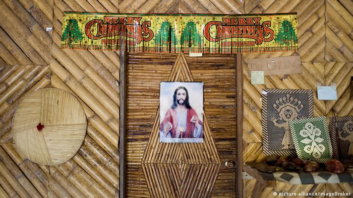 A picture of Jesus in a traditional Malaysian house