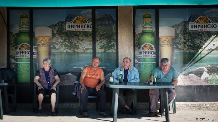 A group of people sitting outside a pub in Bobov Dol, Bulgaria