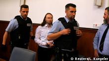 Sergej W., suspected of detonating three bombs targeting the Borussia Dortmund soccer team bus in April 2017, arrives for his verdict at a court in Dortmund, Germany, November 27, 2018. REUTERS/Leon Kuegeler