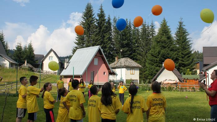 A group of kids with balloons