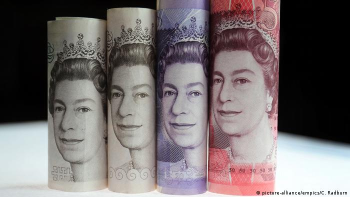 UK pound notes rolled up