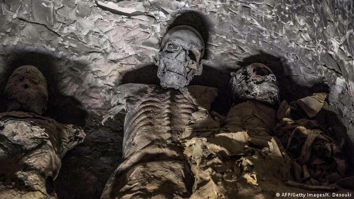 A group of mummies stacked together at the site of Tomb TT28, found in 201